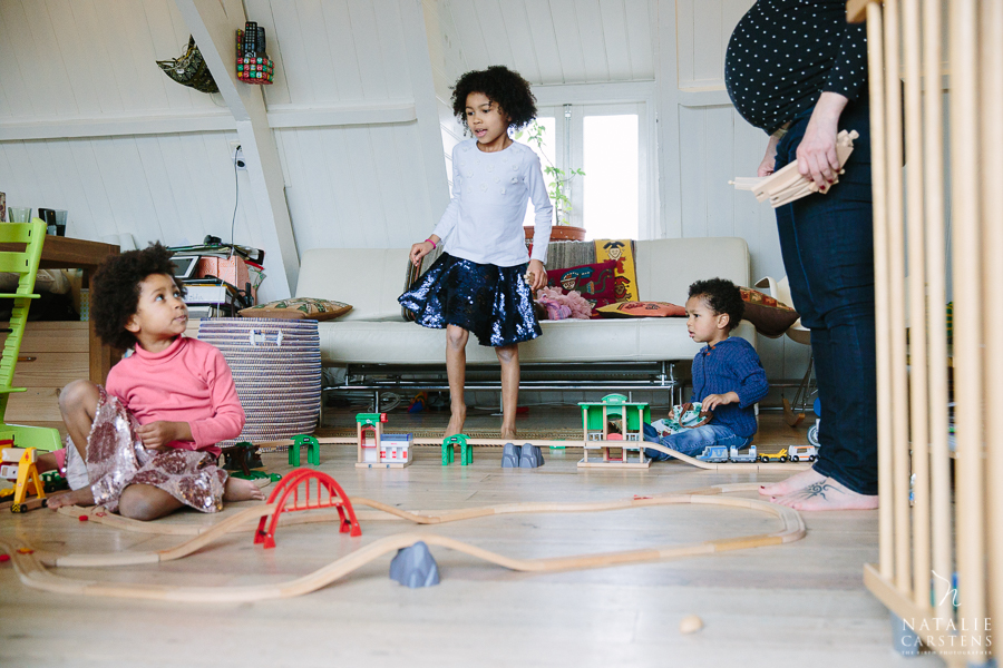 pregnant mother building train tracks with her children | Photographer: Natalie Carstens, nataliecarstens.com