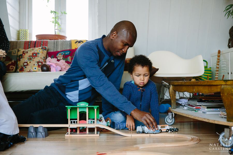 father and son playing with a train set | Photographer: Natalie Carstens, nataliecarstens.com