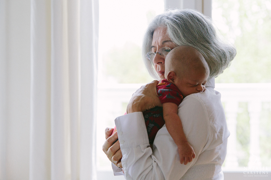 grandmother holding her sleeping baby grandson | Photographer: Natalie Carstens, nataliecarstens.com