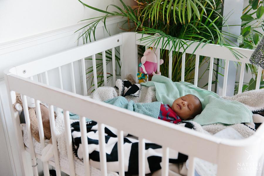 newborn baby boy is sleeping in his baby box /crib | Photographer: Natalie Carstens, nataliecarstens.com