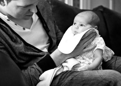 Father and daughter. Documentary in-home newborn baby family photoshoot by Photographer Natalie Carstens, The Hague