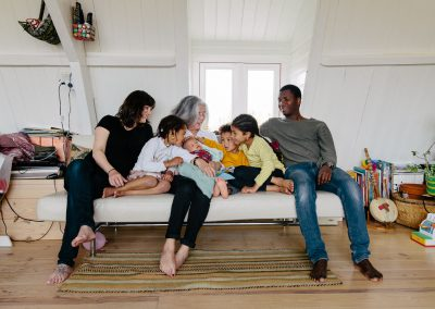 Documentary in-home extended family (with newborn baby and grandmother) photoshoot by Photographer Natalie Carstens, The Hague