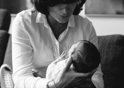 Mother and daughter. Documentary in-home newborn baby family photoshoot by Photographer Natalie Carstens, The Hague
