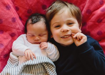 Siblings. Documentary in-home newborn baby family photoshoot by Photographer Natalie Carstens, The Hague